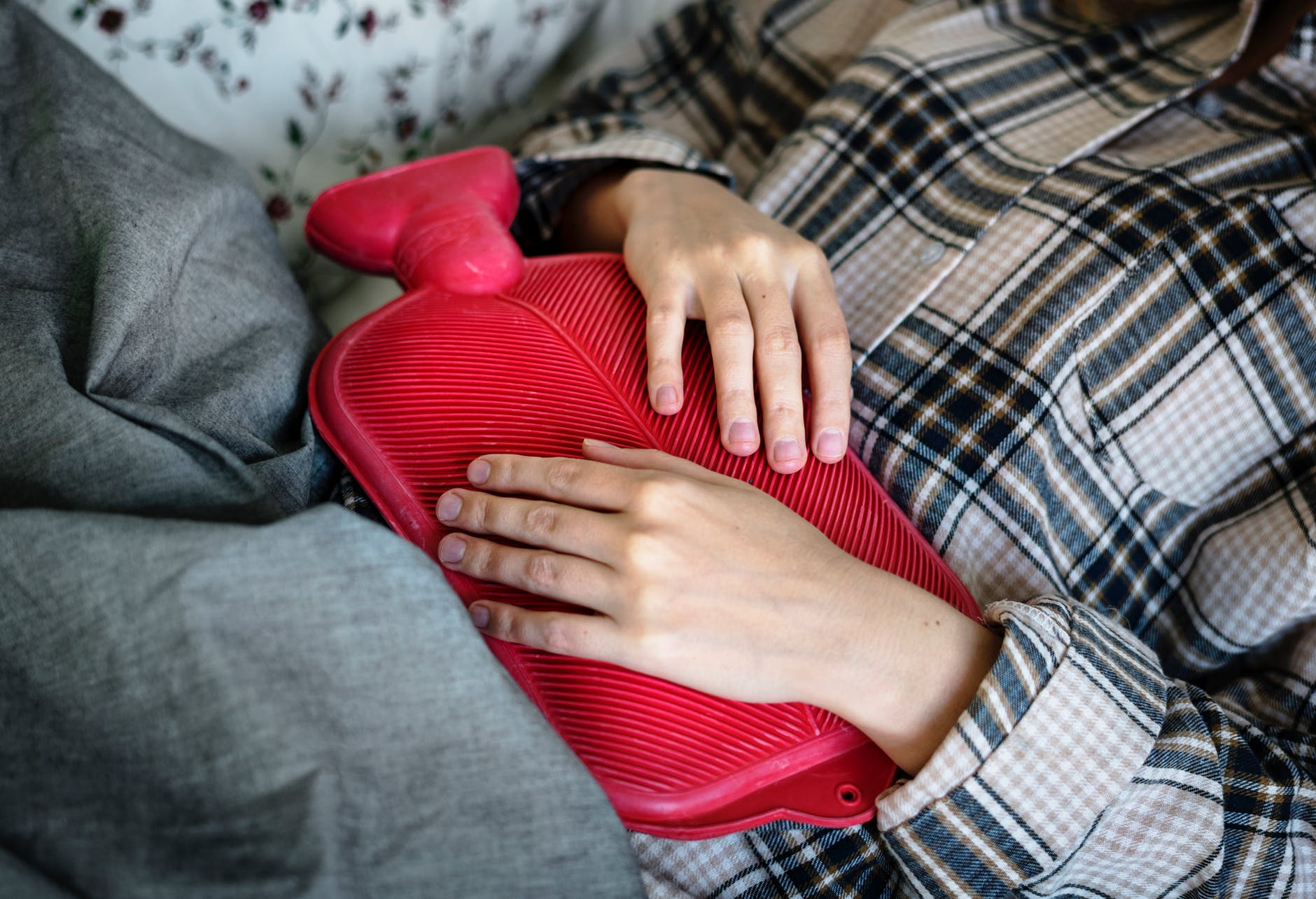 person holding red hot compress